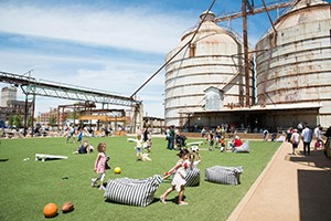 Kids playing beside the Waco silos.