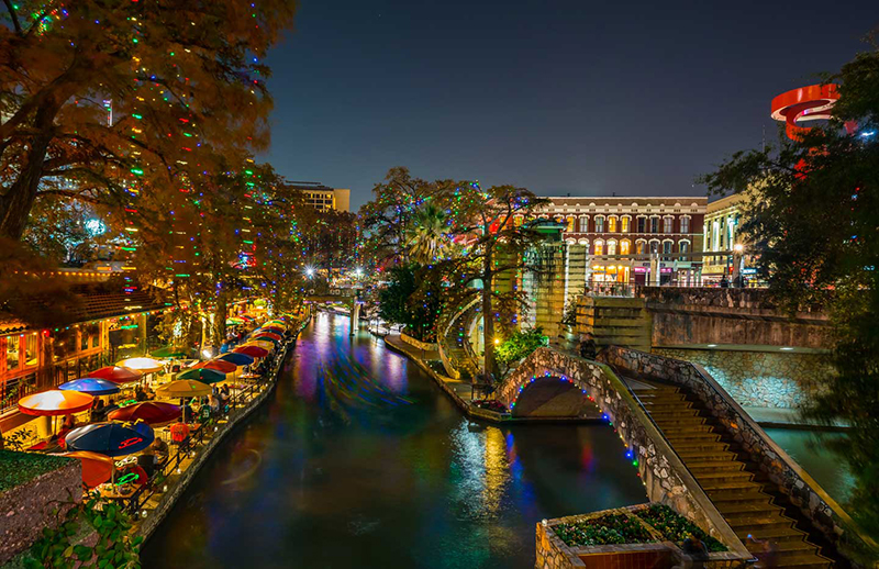 A nightime view of the San Antonio Riverwalk.